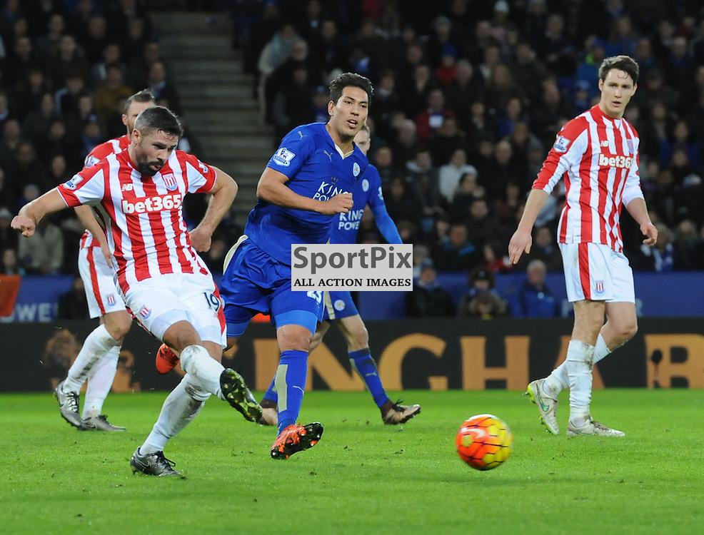 Jonathan Walters clears under pressure from Leonardo Ulloa (c) Simon Kimber | SportPix.org.uk
