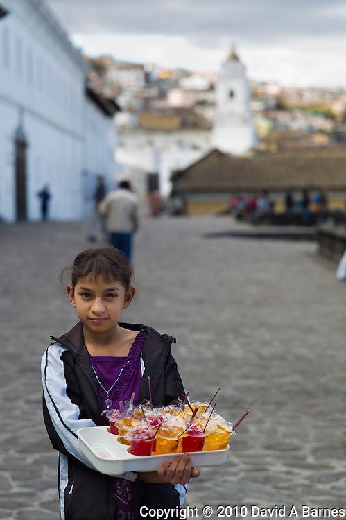Young girl vending jello on street, Quito, Ecuador