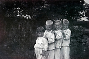 smiling children posing outdoors Netherlands 1950s