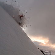 Jim Ryan skis powder and gets air at sunrise in the Teton backcountry.