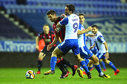 Andrew Surman of Bournemouth is tackled by Will Grigg of Wigan Athletic - Mandatory by-line: Robbie Stephenson/JMP - 17/01/2018 - FOOTBALL - DW Stadium - Wigan, England - Wigan Athletic v Bournemouth - Emirates FA Cup third round proper