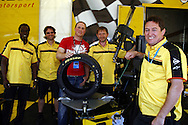 HiQ BTCC event Rockingham..Rushden HiQ Fitter, Gary Upton, with some of the Dunlop onsite crew