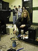 Eric Roucou cooking meat, Stranded: 25 Artists. Old Aldwych Tube Station, The Strand, WC1<br />2 April 2002. © Copyright Photograph by Dafydd Jones 66 Stockwell Park Rd. London SW9 0DA Tel 020 7733 0108 www.dafjones.com