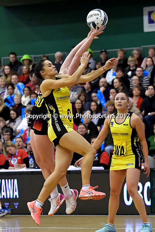 Pulse's Sheridan Bignall (Front) intercepts a pass to Magic's Sam Sinclair during the ANZ Premiership netball match between the Pulse and Magic at the Central Energy Trust Arena in Palmerston North on Monday the 5th of June 2017. Copyright Photo by Marty Melville / www.Photosport.nz