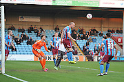 David Mirfin of Scunthorpe United clears ball from goal area during the Sky Bet League 1 match between Scunthorpe United and Bury at Glanford Park, Scunthorpe, England on 19 April 2016. Photo by Ian Lyall.