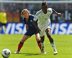 26.06.2011, Rhein-Neckar-Arena, Sinsheim, GER, FIFA Women´s Worldcup 2011, GRUPPE A, NIGERIA (NGA) vs FRANKREICH (FRA) , im Bild Sonia BOMPASTOR (FRA #8, FCF Lyon) im Zweikampf mit Perpetua NKWOCHA (NGA #4,Sunnana SWE)   // during the FIFA Women´s Worldcup 2011, Pool A, Nigeria (NGA) vs France (FRA) on 2011/06/26, Rhein-Neckar-Arena, Sinsheim, Germany. EXPA Pictures © 2011, PhotoCredit: EXPA/ nph/  Roth       ****** out of GER / SWE / CRO  / BEL ******