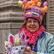 The parade is best known for participants' elaborate bonnets and colorful costumes.<br /> <br /> The Easter parade is an American cultural event consisting of a festive strolling procession on Easter Sunday. Typically, it is a somewhat informal and unorganized event, with or without religious significance. <br /> <br /> Persons participating in an Easter parade traditionally dress in new and fashionable clothing, particularly ladies' hats, and strive to impress others with their finery. The Easter parade is most closely associated with Fifth Avenue in New York City, but Easter parades are held in many other cities. Starting as a spontaneous event in the 1870s