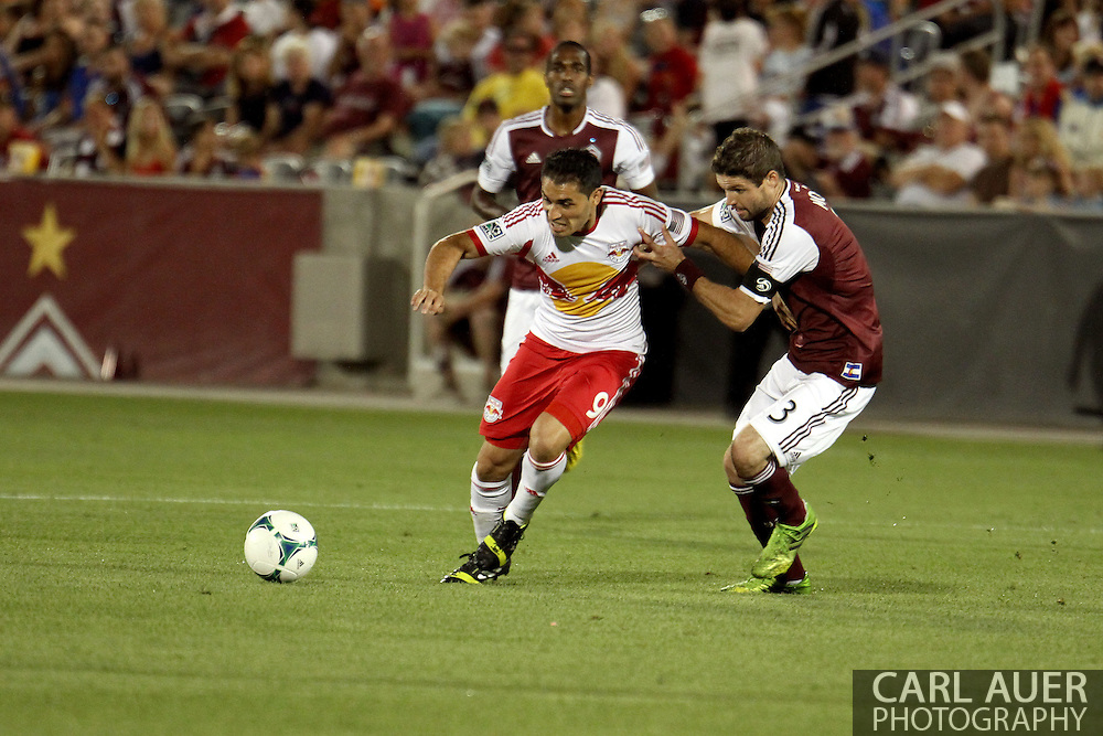 July 4th, 2013 - New York Red Bulls forward Fabian Espindola (9) attempts to get past Colorado Rapids defender Drew Moor (3) in the second half of action in the Major League Soccer match between New York Red Bulls and the Colorado Rapids at Dick's Sporting Goods Park in Commerce City, CO
