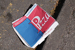 Pizza box dropped on the street ,