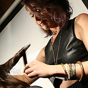 Stylist Erin Brown from Hush Salon performing on stage during scissor candy open chair 13 Sunday, Sept. 14, 2014 at National Mechanic in Philadelphia Pennsylvania.