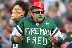 Dec 2, 2012; East Rutherford, NJ, USA; New York Jets fans dress up as New York Jets quarterback Mark Sanchez (6) and Fireman Ed Anzalone during the first half at MetLIfe Stadium.
