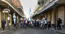 09 February 2016. New Orleans, Louisiana.<br /> Mardi Gras Day. Walking with Skeletons. The Skeleton Krewe walk through the French Quarter. The Krewe meets before sunrise and walks 5 miles from Uptown, making their way along St Charles Avenue and into the French Quarter where they celebrate Mardi Gras Day.<br /> Photo©; Charlie Varley/varleypix.com