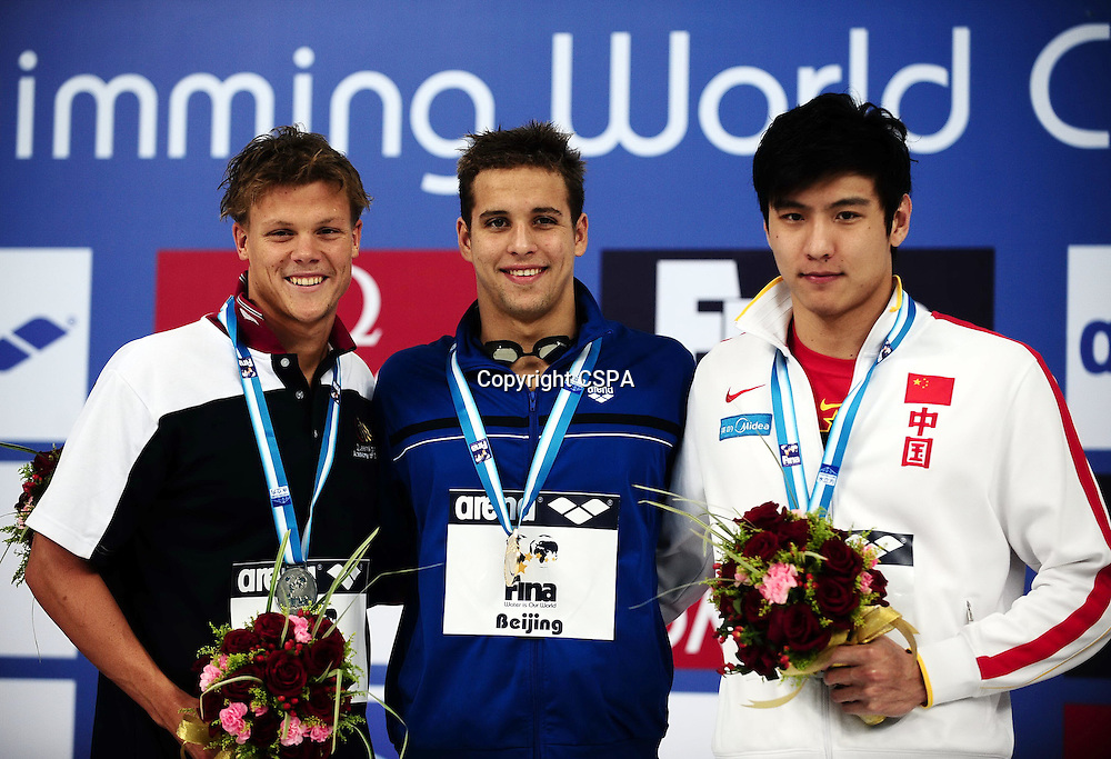 Nov 08, 2011; Beijing, CHINA; (L-R) Christopher Wright of Australia, Chad Guy Bertrand Le Clos of South Africa and Chen Weiwu of China get silver, gold and bronze medal in the final of Men's 200m butterfly on day one of the FINA/ARENA Swimming World Cup 2011 at the National Aquatics Center.