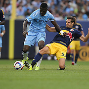 Kwadwo Poku, (left), NYCFC, is challenged by Damien Perrinelle, New York Red Bulls, during the New York City FC Vs New York Red Bulls, MSL regular season football match at Yankee Stadium, The Bronx, New York,  USA. 28th June 2015. Photo Tim Clayton