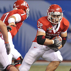 Dec 19, 2009; St. Petersburg, Fla., USA; Rutgers running back Joe Martinek (38) takes the handoff during NCAA Football action in Rutgers' 45-24 victory over Central Florida in the St. Petersburg Bowl at Tropicana Field.