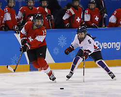 February 18, 2018 - Pyeongchang, KOREA - Switzerland defenseman Christine Meier (19) and Korea forward Caroline Nancy Park (5) in a hockey game between Switzerland and Korea during the Pyeongchang 2018 Olympic Winter Games at Kwandong Hockey Centre. Switzerland beat Korea 2-0. (Credit Image: © David McIntyre via ZUMA Wire)