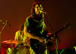 © Licensed to London News Pictures. 25/06/2013. London, UK.   Tame Impala performing live at Hammersmith Apollo.  Tame Impala is a psychedelic rock band from Perth, Australia, composed of band members Kevin Parker (vocals, guitar), Dominic Simper (guitar/synth), Cam Avery (bass)  and Julien Barbagallo (drums).   Photo credit : Richard Isaac/LNP