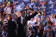 Presidential Candidate Barak Obama and Vice Presidential candidate Senator Joseph Biden Jr. wave to crowds  on the third night of the Democratic Convention in Denver,Colorado, August 27, 2008. Photograph by Dennis Brack