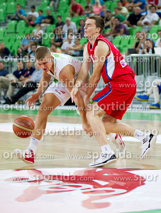 Edo Muric of Slovenia vs Danilo Andusic of Serbia during basketball match between National teams of Slovenia and Serbia in day 3 of Adecco cup, on August 5, 2012 in Arena Stozice, Ljubljana, Slovenia. (Photo by Vid Ponikvar / Sportida.com)