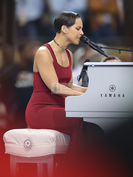 Recording artist Alicia Keys performs the National Anthem before Super Bowl XLVII at the Mercedes-Benz Superdome in New Orleans, LA on Sunday, February 3, 2013. (Photo by Jed Jacobsohn)
