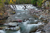 Rushing waters of McDonald Creek Glacier National Park Montana USA