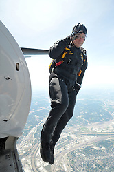 August 23, 2008, Kansas City, MO: U.S. Army Golden Knights team member SGT Eric Holman salutes as he makes his jump at 12,500 feet above Kansas City at the KC Airshow at Wheeler Downtown Airport, Kansas City, MO