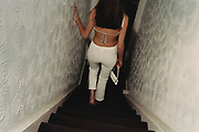 Back View of Woman in White Pants Walking down Stairs
