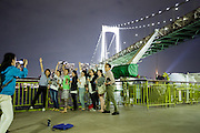 Tokyo, Japan, May 24 2016 - Passengers on the Tokai Kisen Ferry leaving Tokyo and the Rainbow Bridge for the Izu islands.