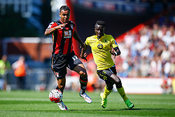 Joshua King of AFC Bournemouth under pressure from Idrissa Gueye of Aston Villa - Mandatory by-line: Jason Brown/JMP - Mobile 07966 386802 08/08/2015 - FOOTBALL - Bournemouth, Vitality Stadium - AFC Bournemouth v Aston Villa - Barclays Premier League - Season opener