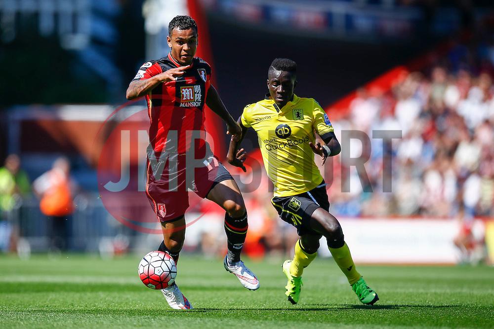 Joshua King of AFC Bournemouth under pressure from Idrissa Gueye of Aston Villa - Mandatory by-line: Jason Brown/JMP - Mobile 07966 386802 08/08/2015 - FOOTBALL - Bournemouth, Vitality Stadium - AFC Bournemouth v Aston Villa - Barclays Premier League - Season opener
