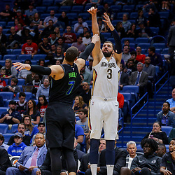 Mar 20, 2018; New Orleans, LA, USA; New Orleans Pelicans forward Nikola Mirotic (3) shoots over Dallas Mavericks center Dwight Powell (7) during the second half at the Smoothie King Center. Pelicans defeated the Mavericks 115-105. Mandatory Credit: Derick E. Hingle-USA TODAY Sports