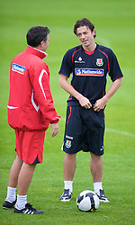 CARDIFF, WALES - Friday, September 5, 2008: Wales' captain Simon Davies and assistant coach Dean Saunders during training at Vale of Glamorgan Hotel ahead of the second 2010 FIFA World Cup South Africa Qualifying Group 4 match against Russia. (Photo by David Rawcliffe/Propaganda)