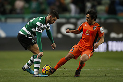 December 17, 2017 - Lisbon, Portugal - Sporting's defender Cristiano Piccini (L) vies for the ball with Portimonense's forward Shoya Nakajima (R)  during Primeira Liga 2017/18 match between Sporting CP vs Portimonense SC, in Lisbon, on December 17, 2017. (Credit Image: © Carlos Palma/NurPhoto via ZUMA Press)