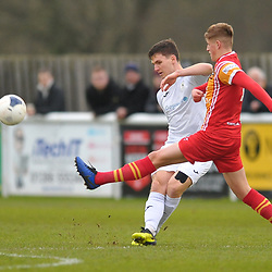 TELFORD COPYRIGHT MIKE SHERIDAN Ross White of Telford clears under pressure from Ross Johnstone of Gloucester during the Vanarama Conference North fixture between AFC Telford United and Gloucester City at Jubilee Stadium, Evesham on Saturday, December 28, 2019.<br />