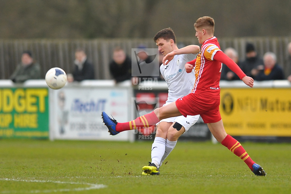 TELFORD COPYRIGHT MIKE SHERIDAN Ross White of Telford clears under pressure from Ross Johnstone of Gloucester during the Vanarama Conference North fixture between AFC Telford United and Gloucester City at Jubilee Stadium, Evesham on Saturday, December 28, 2019.<br /> <br /> Picture credit: Mike Sheridan/Ultrapress<br /> <br /> MS201920-037