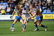 Sam Kelly of Port Vale FC holds off Shaun Whalley of Shrewsbury Town and Jack Grimmer of Shrewsbury Town during the Sky Bet League 1 match between Shrewsbury Town and Port Vale at Greenhous Meadow, Shrewsbury, England on 25 March 2016. Photo by Mike Sheridan.