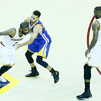 08 June 2016: Golden State Warriors guard Stephen Curry (30) defends on Cleveland Cavaliers guard Kyrie Irving (2) next to Cleveland Cavaliers forward LeBron James (23) during the Cleveland Cavaliers 120-90 victory over the Golden State Warriors, during Game Three of the 2016 NBA Finals at the Quicken Loans Arena, Cleveland, Ohio, USA.