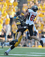 August 31 2013: Northern Illinois Huskies wide receiver Angelo Sebastiano (85) pulls in a pass over Iowa Hawkeyes defensive back B.J. Lowery (19) during the second half of the NCAA football game between the Northern Illinois Huskies and the Iowa Hawkeyes at Kinnick Stadium in Iowa City, Iowa on August 31, 2013. Northern Illinois defeated Iowa 30-27.