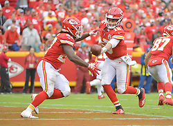 Oct 7, 2018; Kansas City, MO, USA; Kansas City Chiefs quarterback Patrick Mahomes (15) hands off to running back Kareem Hunt (27) during the second half against the Jacksonville Jaguars at Arrowhead Stadium. Mandatory Credit: Denny Medley-USA TODAY Sports