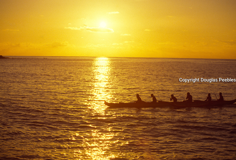 Outrigger canoe at sunset<br />
