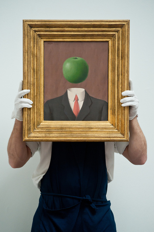 London,UK - 7 June 2013: A Sotheby's employee named Pietro holds ?L'idee? by Rene Magritte (Est. 1.8 - 2.5million) during the preview of this summer auction at Sotheby's estimated at £100 million.