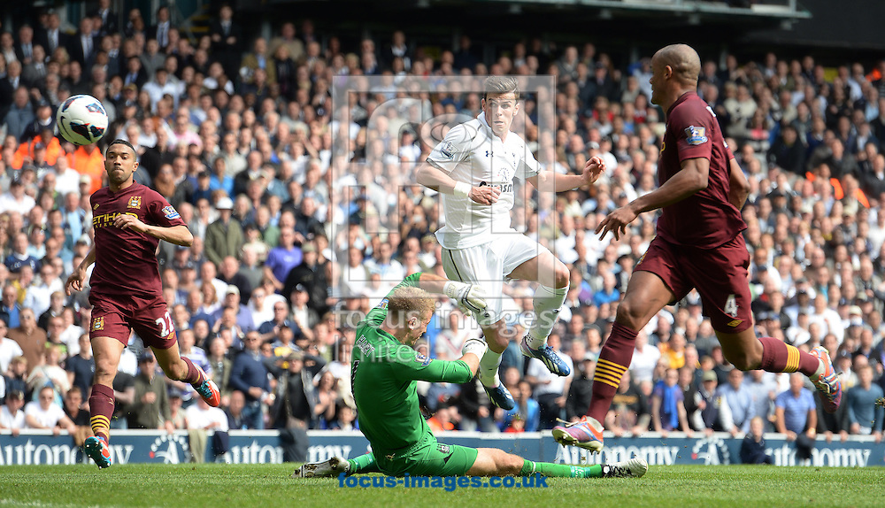 Picture by Andrew Timms/Focus Images Ltd +44 7917 236526.21/04/2013.Gareth Bale of Tottenham Hotspur scoring their third goal during the Barclays Premier League match against Manchester City at White Hart Lane, London.