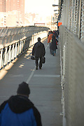 people walking towards work during subway strike New York City December 2005 crossing the Manhattan Bridge