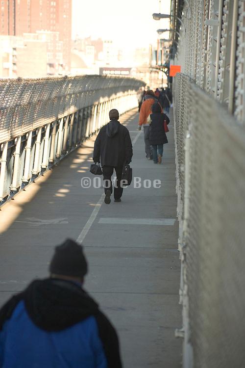 people walking towards work during subway strike New York City December 2005 crossing the Manhattan Bridge