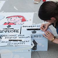 """VENICE, ITALY - MAY 27:  A woman writes her suggestions during a protest organised by supporters of the Spanish movement """"Democracia Real Ya""""  on May 27, 2011 in Venice, Italy. The protest takes place on the day when Spanish police fired rubber bullets to disperse anti-crisis protesters in a Barcelona square as cleaning crews cleared their tent camp."""