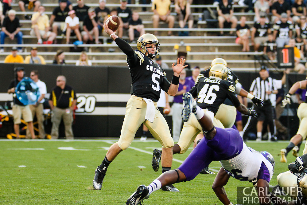 September 7th, 2013 - Colorado Buffaloes junior quarterback Connor Wood (5) passes the ball in the first quarter of the NCAA football game between the University of Central Arkansas Bears and the University of Colorado Buffaloes at Folsom Field in Boulder, CO