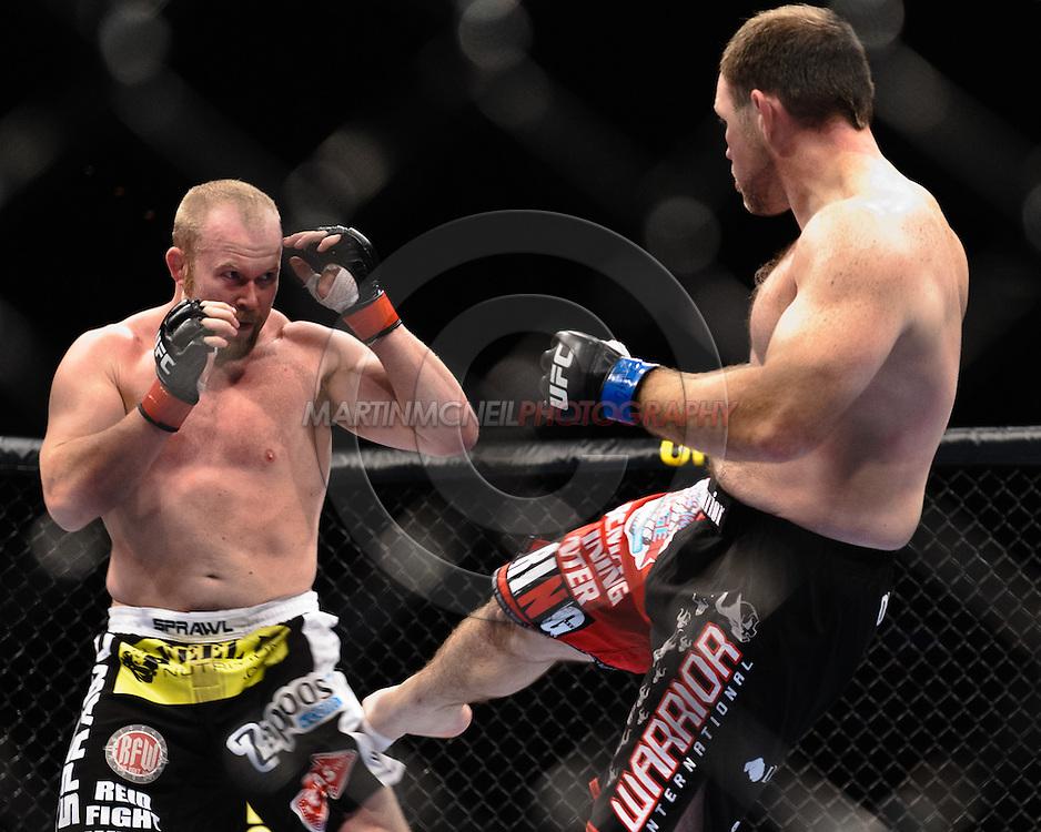 "ATLANTA, GEORGIA, SEPTEMBER 6, 2008: Tim Boetsch (left) covers up from a kick by Mike Patt during ""UFC 88: Breakthrough"" inside Philips Arena in Atlanta, Georgia on September 6, 2008"