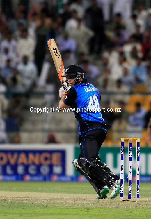 Pakistan vs New Zealand, 19th December 2014. Tom Latham plays a shot in the 5th ODI in Abu Dhabi