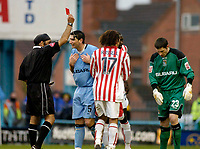 Photo. Glyn Thomas. 22/02/2005.<br /> Coventry City v Stoke City. Coca Cola Championship.<br /> Coventry's keeper Ian Bennett (R) is shown the red card by referee Jarnail Singh (L) for handling the ball outside the area. Bennett protests his innocence.