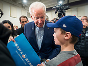 04 JANUARY 2020 - DES MOINES, IOWA: Former Vice President JOE BIDEN signs an Obama/Biden placard from 2012 for a boy on the rope line at the end of a campaign event in Des Moines. Vice President Biden is touring Iowa this week to support his candidacy for the US Presidency. Iowa hosts the first presidential selection event of the 2020 election cycle. The Iowa caucuses are on February 3, 2020.      PHOTO BY JACK KURTZ